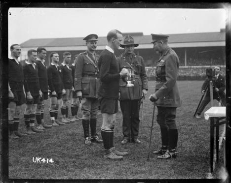 King_George_V_presents_a_cup_to_the_captain_of_the_winning_New_Zealand_Services_Rugby_Team,_London