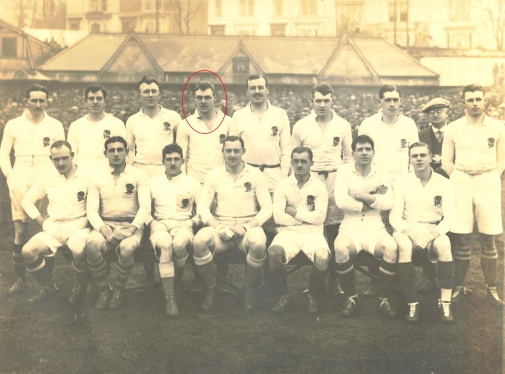 1920 England rugby team seating and standing for a team photo. Wakefield is circled in red in the back row.